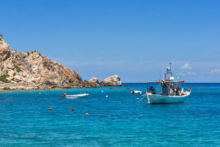 Small Boat in the Blue waters of Ionian sea, near Agios Nikitas village, lefkada Stock Photo