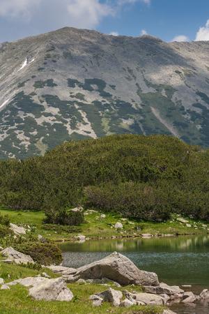 Amazing view of Muratovo Lake and reflection of Todorka Peak, Pirin Mountain, Bulgaria