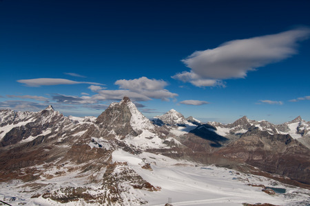 Matterhorn covered with clouds on a clear day after snow fall in autumn,  Valais, Switzerland