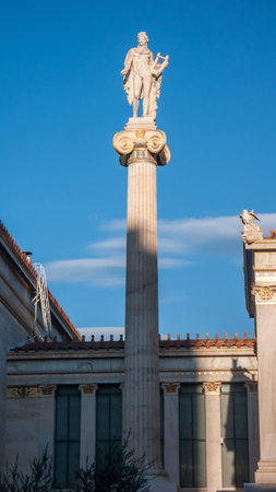 Sunset view of Apollo statue in front of Academy of Athens, Attica, Greece Editorial