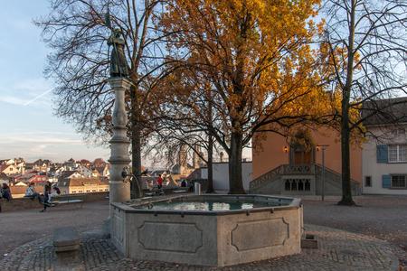 ZURICH, SWITZERLAND - 28 OCTOBER 2015 : Sunset view of old town of City of Zurich in Limmat River, Switzerland