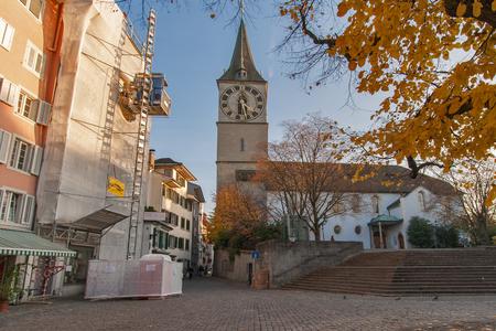 ZURICH, SWITZERLAND - 28 OCTOBER 2015 : St. Peter Church and autumn trees, City of Zurich, Switzerland Editorial