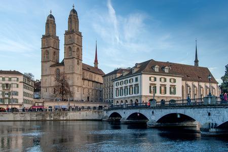 ZURICH, SWITZERLAND - 28 OCTOBER 2015 : Sunset view Grossmunster church in Limmat River, City of Zurich, Switzerland