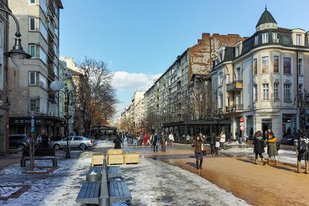 SOFIA, BULGARIA - FEBRUARY 5, 2017: Walking people on Boulevard Vitosha in Winter in city of Sofia, Bulgaria