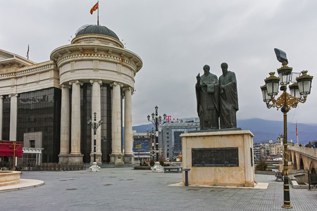 SKOPJE, REPUBLIC OF MACEDONIA - FEBRUARY 24, 2018:  Monument of St. Cyril and Methodius and Archaeological Museum, Republic of Macedonia