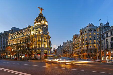 MADRID, SPAIN - JANUARY 23, 2018: Sunset view of Gran Via and Metropolis Building (Edificio Metropolis) in City of Madrid, Spain Editorial