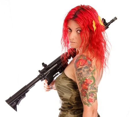 Red-haired woman with gun and uniform photo