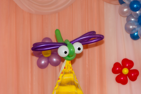 twisting: toy dragonfly made of baloons twisting