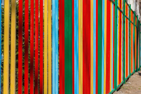poling: colorful painted metal fence on a sunny day