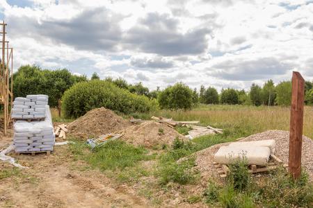 debris: construction material and debris in a field