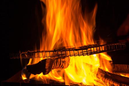 brazier: empty grill rack on fire burning in brazier