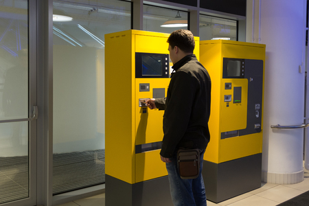 car parking: man pays parking in parking machine in the mall Stock Photo