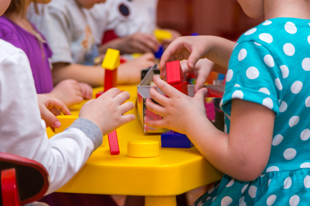 handbreadth: children hands building towers out of wooden bricks Stock Photo