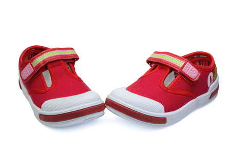 velcro: pair of red child  sneakers isolated on white background Stock Photo
