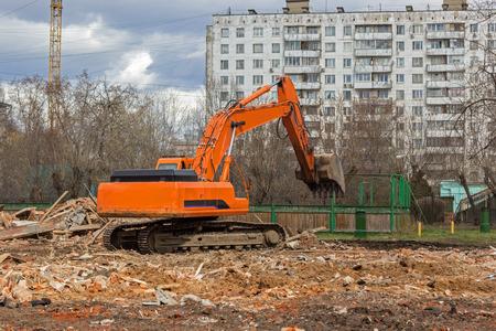 crawler: crawler excavator removes construction waste after building demolition