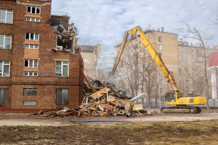 building bricks: excavator demolishes old soviet school building in moscow