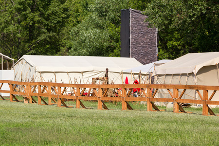 MOSCOW, RUSSIA - JUNE 7, 2015: ancient Roman tent camp with a catapult at Times and Epochs: Rome historical festival Editorial