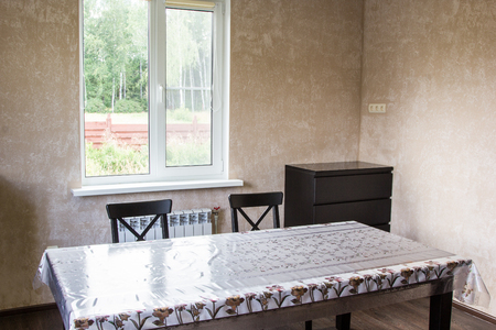 dining table and chairs: dining table and two chairs in a country house