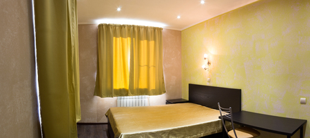 bedder: bed in the bedroom in shades of yellow Stock Photo