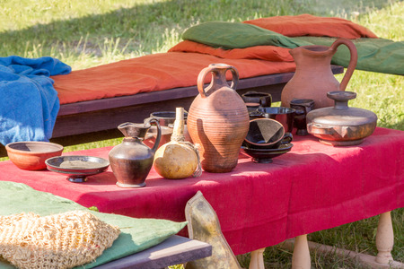 coverings: clay utensils on a table with a red cloth coverings Stock Photo