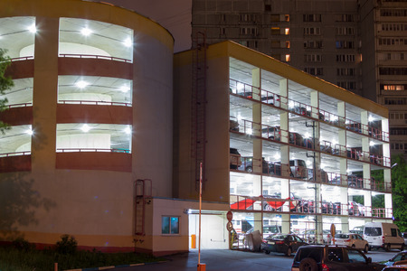 brightly lit: multistory brightly lit parking lot by night Editorial