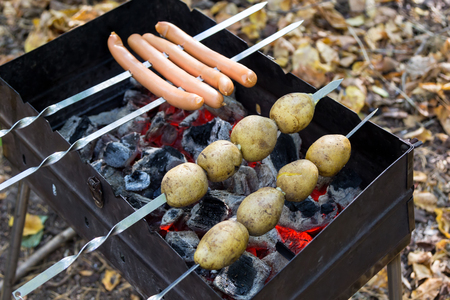 chargrill: potatoes and sausages fried on coals in the grill