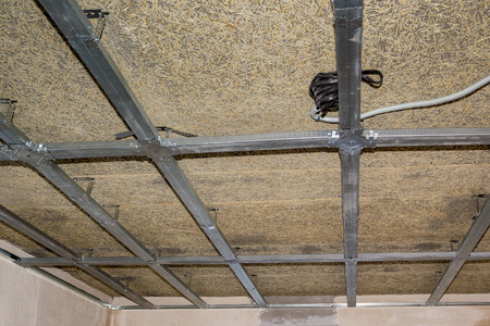 suspended: frame of suspended ceiling, electrical wiring and fiberboard