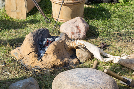 fireplace bellows: ancient clay forge, furs, hammer, mites and other tools Stock Photo
