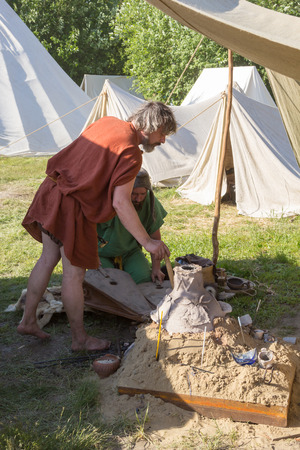 MOSCOW, RUSSIA - JUNE 7, 2015: smiths blows furs at Times and Epochs: Rome historical festival