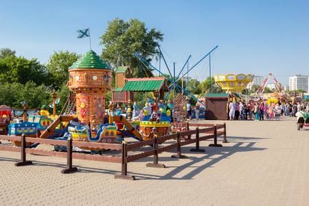 city park boat house: MOSCOW - June 7, 2015: children carousel in the city amusement park