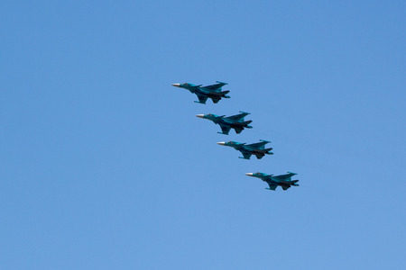 modern fighter: Moscow, Russia - May 5, 2015: warplanes fulfill aerobatics ready for the parade in honor of Victory Day