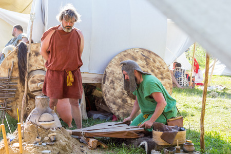 ancient blacksmith: MOSCOW, RUSSIA - JUNE 7, 2015: smiths blows furs at Times and Epochs: Rome historical festival