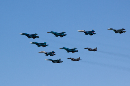 aerobatics: Moscow, Russia - May 5, 2015: warplanes fulfill aerobatics ready for the parade in honor of Victory Day