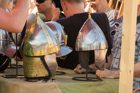 cascos romanos: MOSCOW, RUSSIA - JUNE 7, 2015: Ancient Roman helmets sold in the market at Times and Epochs: Rome historical festival