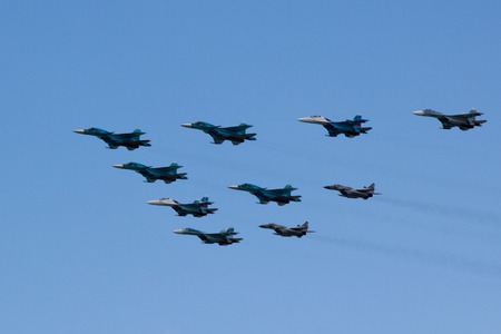 fulfill: MOSCOW - MAY 5, 2015: warplanes fulfill aerobatics ready for the parade in honor of Victory Day Editorial