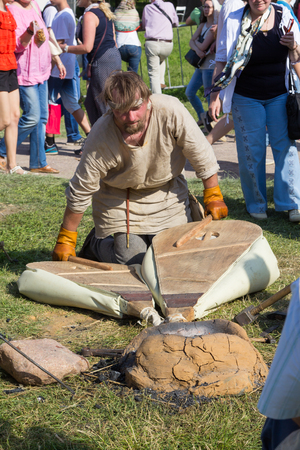 MOSCOW, RUSSIA - JUNE 7, 2015: blacksmith blows furs at Times and Epochs: Rome historical festival