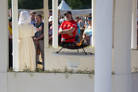 priestess: MOSCOW, RUSSIA - JUNE 7, 2015: priestess in the temple near the brazier at Times and Epochs: Rome historical festival