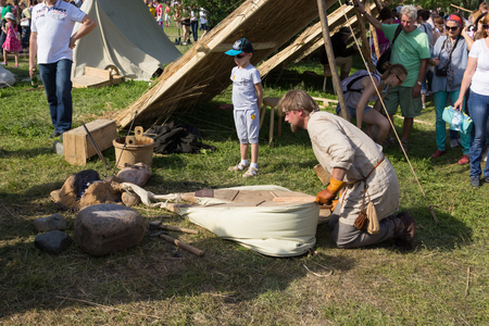 fireplace bellows: MOSCOW, RUSSIA - JUNE 7, 2015: blacksmith blows furs at Times and Epochs: Rome historical festival