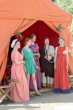 sandal tree: MOSCOW, RUSSIA - JUNE 7, 2015: Five women in ancient Roman dresses at Times and Epochs: Rome historical festival