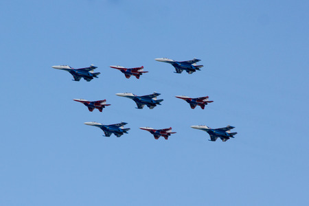 supersonic transport: MOSCOW - MAY 5, 2015: warplanes fulfill aerobatics ready for the parade in honor of Victory Day Editorial
