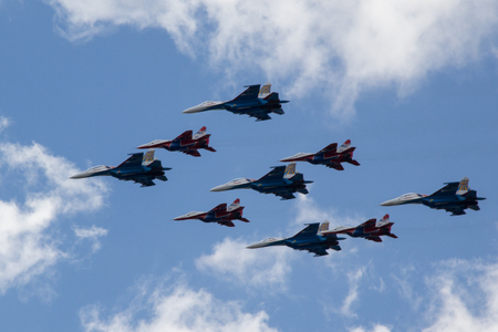 interceptor: Moscow, Russia - May 5, 2015: warplanes fulfill aerobatics ready for the parade in honor of Victory Day