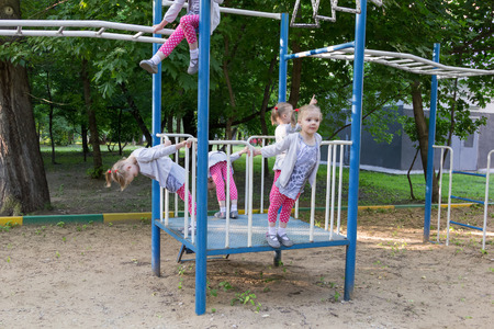 copies: five copies of cute little girl on the playground