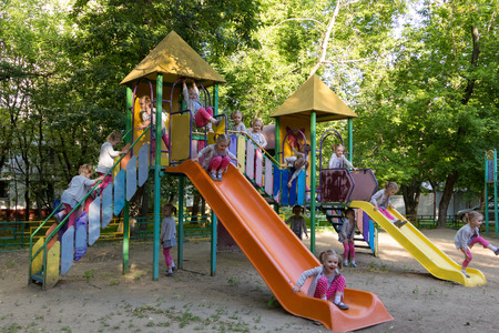 fifteen clones of cute little girl at children playground
