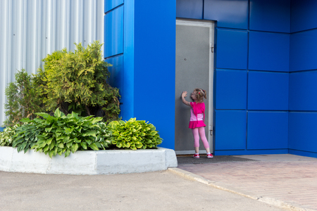 little girl with tails knocking on the steel door