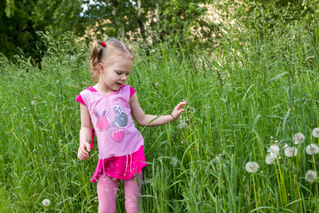 gramineous: little girl with pigtails in the tall grass