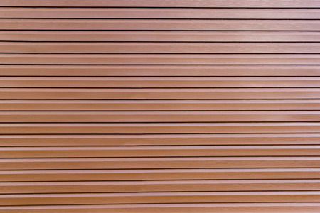 siding: background of glossy brown vinyl siding planks Stock Photo