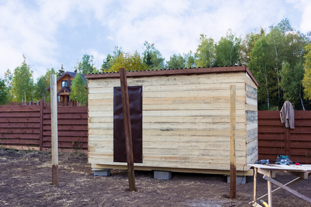 build buzz: wooden poles for the canopy extension to the barn