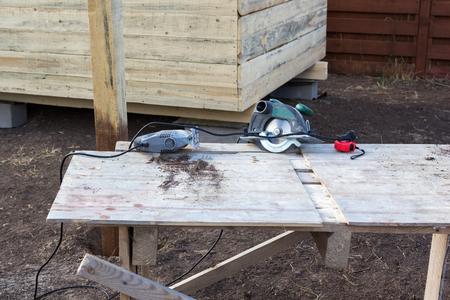 build buzz: jigsaw and circular saw on a workbench Stock Photo