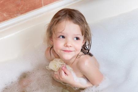 wisp: little girl taking a bath with foam