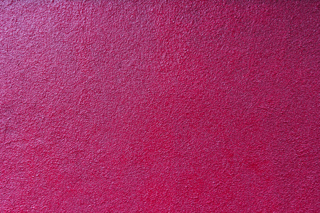 plastered: contrastly lit crimson rough plastered painted wall Stock Photo